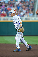 Dalton Guthrie (5) of the Florida Gators throws during a game between the Miami Hurricanes and Florida Gators at TD Ameritrade Park on June 13, 2015 in Omaha, Nebraska. (Brace Hemmelgarn/Four Seam Images)