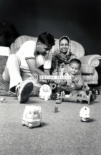 Parents playign with their toddler son UK 1990s