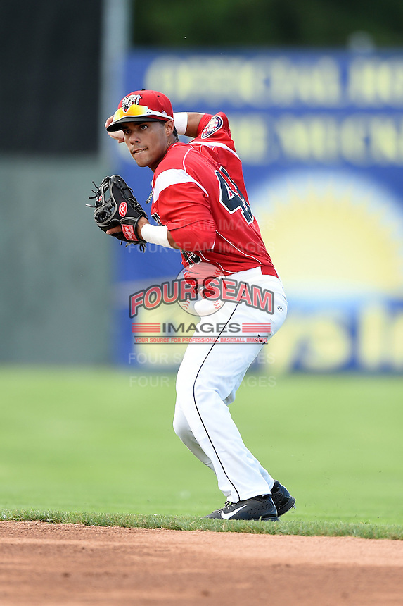 Batavia Muckdogs second baseman Iramis Olivencia (49) throws to first during a game against the Williamsport Crosscutters on July 27, 2014 at Dwyer Stadium in Batavia, New York.  Batavia defeated Williamsport 6-5.  (Mike Janes/Four Seam Images)