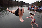 Two particpans leap off the bridge during the 23rd annual Olalla polar bear jumper leap into the Burley lagoon in Olallar, Washington on January 1, 2007. Jim Bryant Photo. ©2010. ALL RIGHTS RESERVED.