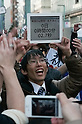 March 16, 2012, Tokyo, Japan - A customer shows the countdown on his iPad 2, the counter shows two seconds nearing completion and opening the store. .Fans lined up overnight outside the Apple store in Ginza, to buy the new iPad. Japan was one of the first countries where Apple fans could get their hands on the new iPad.