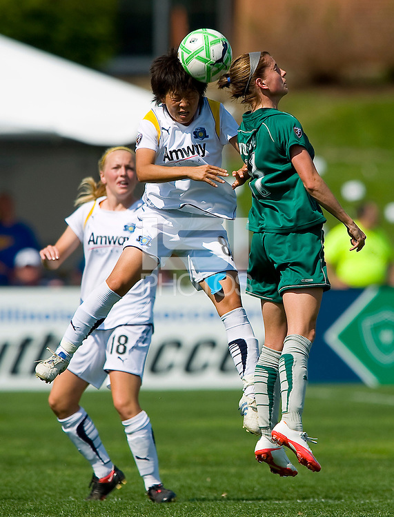 Los Angeles Sol midfielder Aya Miyama (8) heads the ball past St Louis Athletica forward Angie Woznuk (11) during a WPS match at Hermann Stadium, in St. Louis, MO, April 25 2009. The match ended in a 0-0 tie.