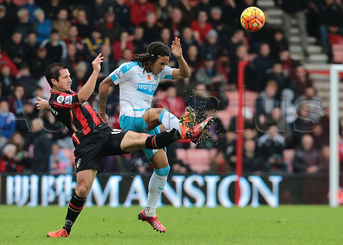 07.11.2015. Vitality Stadium, Bournemouth, England. Barclays Premier League. Yann Kermorgant of Bournemouth clashes feet with Kevin Mbabu of Newcastle as Bournemouth push for the equaliser