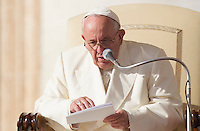 Papa Francesco mima l'uso di uno smartphone durante l'udienza generale del mercoledi' in Piazza San Pietro, Citta' del Vaticano, 11 novembre 2015. Il Santo Padre ha esortato le famiglie a mettere da parte la tv, gli smartphone e i tablet per recuperare la convivialita'.<br /> Pope Francis mimes to use a smartphone during his weekly general audience in St. Peter's Square at the Vatican, 11 November 2015. The Pontiff urged families to put aside their smart phones and social media feeds and learn how to talk to one another again.<br /> UPDATE IMAGES PRESS/Riccardo De Luca<br /> <br /> STRICTLY ONLY FOR EDITORIAL USE