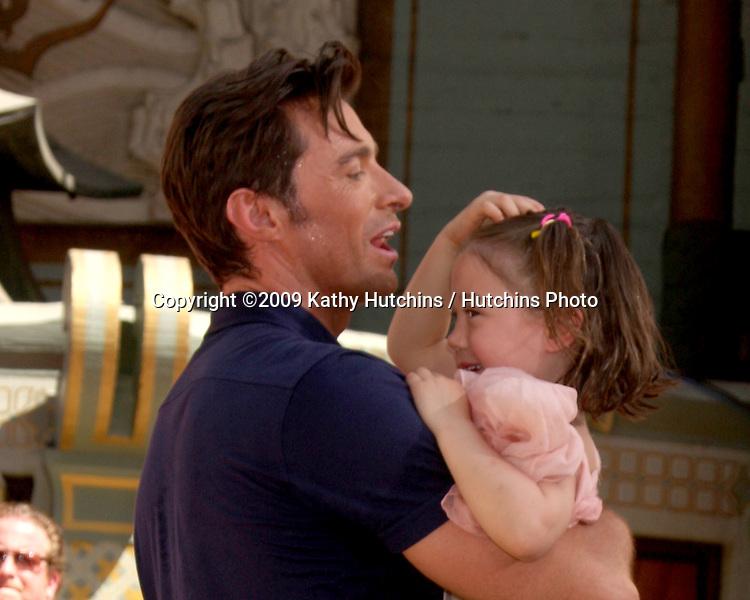 Hugh Jackman & Daughter Ava   at the Hugh Jackman Handprint & Footprint Ceremony at Grauman's Chinese Theater Forecourt in Los Angeles,  California on April 21, 2009.©2009 Kathy Hutchins / Hutchins Photo....                .