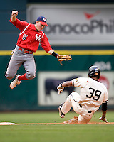 Houston Cougars SS Blake Kelso (#5) leaps against the Missouri Tigers on Friday March 5th, 2100 at the Astros College Classic in Houston's Minute Maid Park.  (Photo by Andrew Woolley / Four Seam Images)