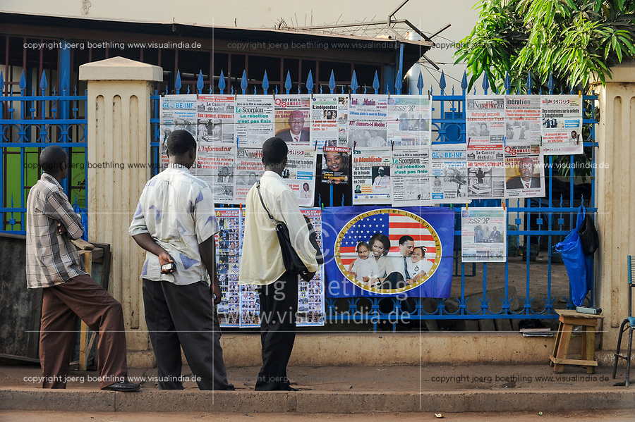 MALI, Bamako , newspaper stand with newspapers in french language and image of Barack Obama family to honor the first afro-american president