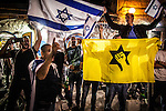Israeli Right wing activists wave theIsraeli flag and the flag of the outlawed terror organization and movement Kach during an Israeli left wing protest and march in Jerusalem Saturday Oct. 17 2015. Photo by Eyal Warshavsky.