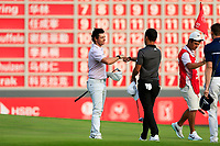 Rory McIlroy (NIR) with Xander Schauffele (USA) on the 18th green during the 3rd round of the WGC HSBC Champions, Sheshan Golf Club, Shanghai, China. 02/11/2019.<br /> Picture Fran Caffrey / Golffile.ie<br /> <br /> All photo usage must carry mandatory copyright credit (© Golffile | Fran Caffrey)