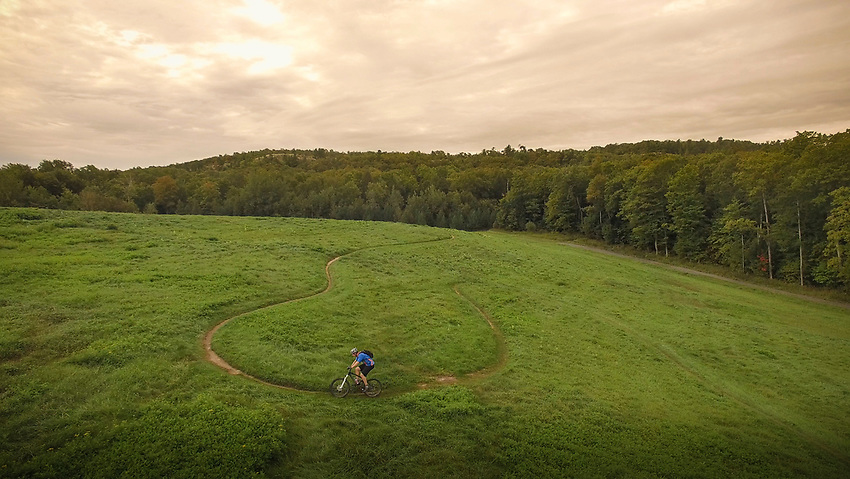 Mountain bikers in the Marji Gesick 100 event follow singletrack during the event in Marquette County, Michigan.