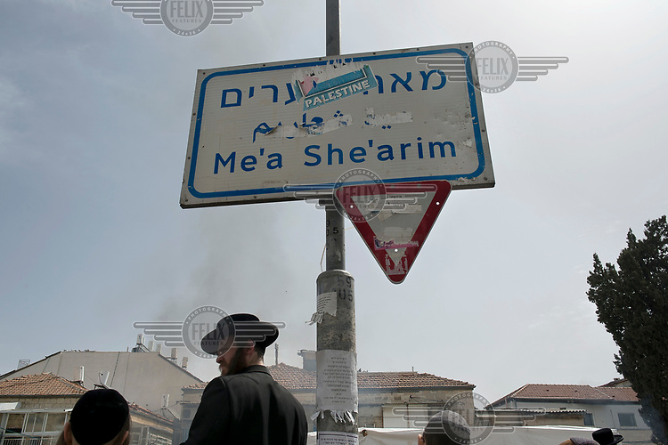 A Palestine sticker on a tri-lingual sign indicating the district of Me'a She'arim. Some ultra extreme sects within ultra-orthodox Jewish society reject the notion of the state of Israel and some express their objection with support for a Palestine state.