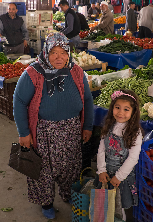 All members of the family turn out to enjoy the shopping at a farmer's market in Korkuteli, Turkey.