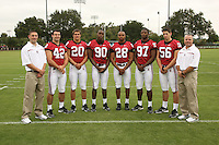 7 August 2006: Position Photos during Stanford Football's Picture Day at the Stanford practice field in Stanford, CA. (L-R): Matt Weiss, Will Powers, Clinton Snyder, Udeme Udofia, Peter Griffin, Emmanuel Awofadeju, Brandon Willetts, Jeff Hammerschmidt.
