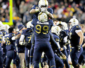 United States Navy Midshipmen safety Tra'ves Bush (9) and defensive end Wes Henderson (99) celebrate their team's 27 - 21 victory over U.S. Army Black Knights at FedEx Field in Landover, Maryland on Saturday, December 10, 2011. The game marked the 112th meeting and the Navy's 10th consecutive victory over Army in the two teams' storied rivalry. .Credit: Ron Sachs / CNP