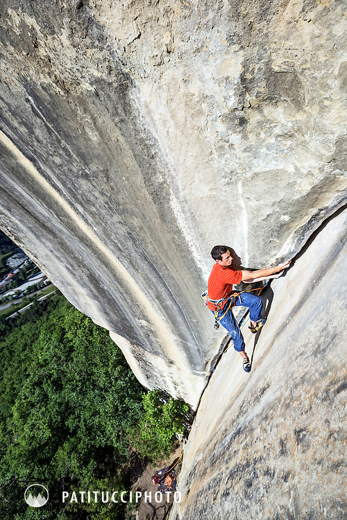 Male rock climber lieback crack climbing on L'Arche, 6c, at Annot, France