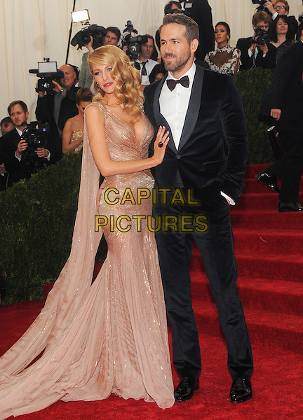NEW YORK, NY - MAY 5: Ryan Reynolds and Blake Lively at the Costume Institute Benefit at The Metropolitan Museum of Art on May 5, 2014 in New York. <br /> CAP/MPI/RTNSTV<br /> &copy;RTNSTV/MPI/Capital Pictures