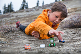 USA, Oregon, Ashland, portrait of 6 year old Christian Rego aka Buddy Backpacker taking a break while hiking the Pacific Crest Trail near Ashland Oregon with his mom Andrea Rego and Dion, Christian will be the youngest hiker to complete the Pacific Crest Trail in a single season