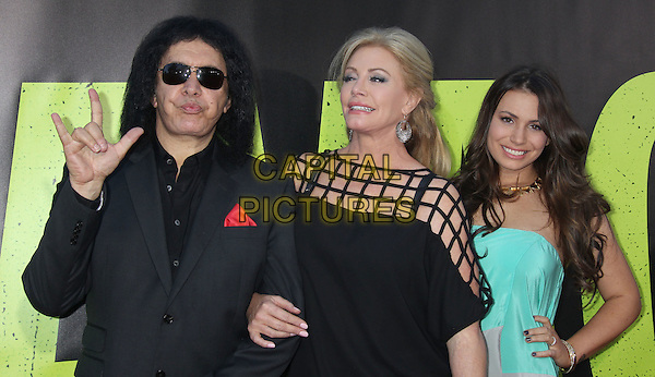 Gene Simmons, Shannon Tweed & Sophie Simmons.The World Premiere of 'Savages' held at The Grauman's Chinese Theatre in Hollywood, California, USA..June 25th, 2012.half length black suit jacket top sunglasses shades couple turquoise strapless daughter family father dad mother mom mum hand finger devil gesture sign leather dress bag purse grey gray shoes hand finger devil gesture sign .CAP/ADM/RE.©Russ Elliot/AdMedia/Capital Pictures.
