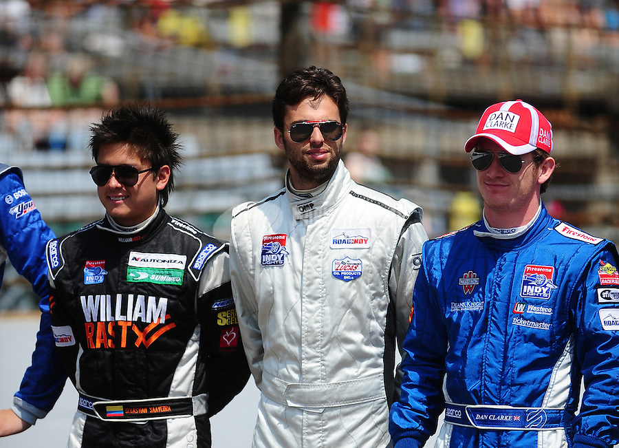 May 28, 2010; Indianapolis, IN, USA; Indy Light Series driver Sebastian Saavedra (left) Adrian Campos Jr. (center) and Dan Clarke during the Freedom 100 at the Indianapolis Motor Speedway. Mandatory Credit: Mark J. Rebilas-