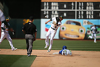 OAKLAND, CA - AUGUST 16:  Whit Merrifield #15 of the Kansas City Royals slides safely into second base against the Oakland Athletics as A's second baseman Jed Lowrie #8 takes a late throw during the game at the Oakland Coliseum on Wednesday, August 16, 2017 in Oakland, California. (Photo by Brad Mangin)
