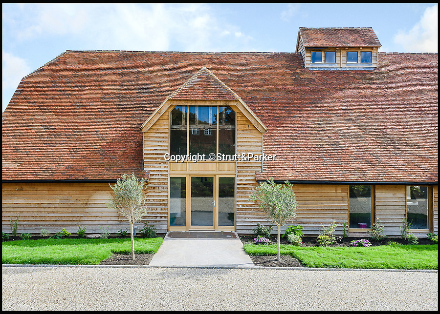 BNPS.co.uk (01202 558833)<br /> Pic: Strutt&Parker/BNPS<br /> <br /> The dilapidated threshing barn in Greywell in Hampshire has been transformed into a open plan modern home.<br /> <br /> These stark before and after pictures show the remarkable transformation of a dilapidated barn into a luxurious home worth £1.25million. <br /> <br /> The ramshackle 16th century structure on a derelict farm was in a state of near ruin before developer Mark Parmenter undertook the colossal project - his first ever barn conversion. <br /> <br /> Mr Parmenter, 60, identified the magnificent 400-year-old beams as the centrepiece of his project. <br /> <br /> Despite the decrepit exterior, which pictures show to have been rusty and crumbling, he was pleasantly surprised to find the inside in remarkably good condition. <br /> <br /> The property is now on the market with Strutt & Parker.