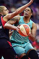 Washington, DC - June 15, 2018: New York Liberty center Kia Vaughn (7) makes a move with the ball guarded by Washington Mystics guard Elena Delle Donne (11) during game between the Washington Mystics and New York Liberty at the Capital One Arena in Washington, DC. (Photo by Phil Peters/Media Images International)
