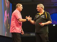 21.12.2014.  London, England.  William Hill World Darts Championship.  Dean Winstanley (26) [ENG] and Wayne Jones [ENG] shake hands after their match. Winstanley own the match 3-2