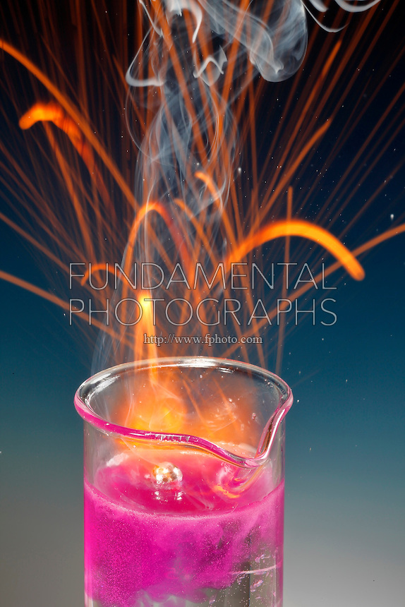 SODIUM REACTS VIOLENTLY WITH WATER<br /> Phenolphthalein Shows Resulting Alkalinity.<br /> Sodium, an alkali metal, dropped in water forms hydrogen gas and an alkali solution of sodium hydroxide. This is a single replacement reaction.  2Na(s) + 2H2O(l) -&gt; 2NaOH(aq) + H2(g)