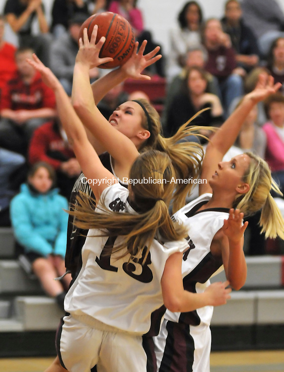 NAUGATUCK, CT-10 DECEMBER 2009-121009JS08-Torrington's Alyssa Otis  (22) pulls down a rebound in front of Naugatuck's Lauren Piroscafo (22) and Renee Augustine (2) during their game Thursday at Naugatuck High School. <br /> Jim Shannon Republican-American