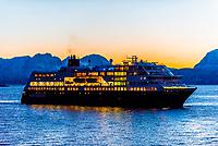 "The Hurtigruten ship ""Trollfjord"" arriving in Harstad predawn, Troms County, in Arctic Northern Norway."