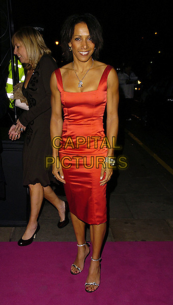 DAME KELLY HOLMES.The Cosmopolitan Fun Fearless Female Awards, .held at the Bloomsbury Ballroom, London, England,.November 7th 2006..full length red dress.Ref: CAN.www.capitalpictures.com.sales@capitalpictures.com.©Can Nguyen/Capital Pictures