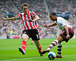 Sunderland's Dean Whitehead and Arsenal's Theo Walcott. during the Premier League match at the Stadium of Light, Sunderland. Picture date 21st May 2008. Picture credit should read: Richard Lee/Sportimage