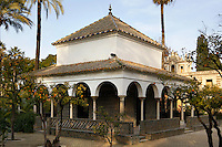 Low angle view of pavilion, Gardens, Real Alcazar, Seville, Spain, pictured on Decmber 26, 2006, in the afternoon. The Real Alacazar was commissioned by Pedro I of Castile in 1364 to be built in the Mudejar style by Moorish craftsmen. The palace, built on the site of an earlier Moorish palace, is a stunning example of the style and a UNESCO World Heritage site. Picture by Manuel Cohen.