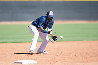 San Diego Padres third baseman Olivier Basabe (8) fields a ground ball during an Instructional League game against the Milwaukee Brewers at Peoria Sports Complex on September 21, 2018 in Peoria, Arizona. (Zachary Lucy/Four Seam Images)