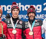 PyeongChang 12/3/2018 - Brian McKeever and his guide Graham Nishikawa collect their gold medals in the men's 20km free, visually impaired, cross country event during the medal ceremony at the PyeongChang Olympic Plaza during the 2018 Winter Paralympic Games in Pyeongchang, Korea. Photo: Dave Holland/Canadian Paralympic Committee