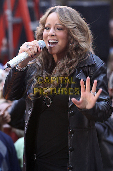 """MARIAH CAREY .performs live on NBC's """"TODAY Show"""", New York, NY, USA, .2nd October 2009..concert music gig on stage performing half length microphone curly wavy hair black leather  diamante sparkly rhinestone jewel encrusted butterfly ring hand singing coat dress buckle .CAP/ADM/PZ.©Paul Zimmerman/Admedia/Capital Pictures"""