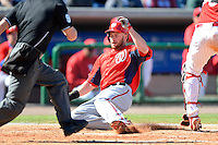 Washington Nationals outfielder Corey Brown #10 slides safely into home during a Spring Training game against the Philadelphia Phillies at Bright House Field on March 6, 2013 in Clearwater, Florida.  Philadelphia defeated Washington 6-3.  (Mike Janes/Four Seam Images)