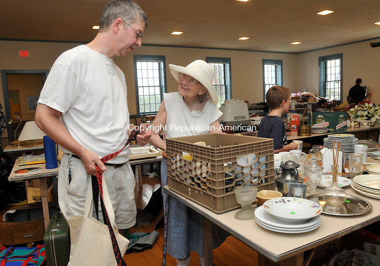 WASHINGTON, CT-24 JULY 2010-072410IP04- FOR COUNTRY LIFE USE  David Rosenstock and his mother Betty Rosenstock, both of New Preston, shop during the Rain Day Tag Sale at the First Congregational Church in Washington on Saturday. The event was held to sell many items donated to the church for its fair a couple weeks ago that had a poor turnout because of rain.<br /> Irena Pastorello Republican-American