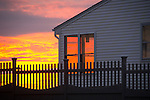 Clinton, CT. Loop Road. Long Island Sound Sunset reflected in house windows.