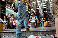 Noodle sellers gather outside an entrance to the Dazheng shopping mall at lunchtime in eastern Yuzhong District, Chongqing, China.