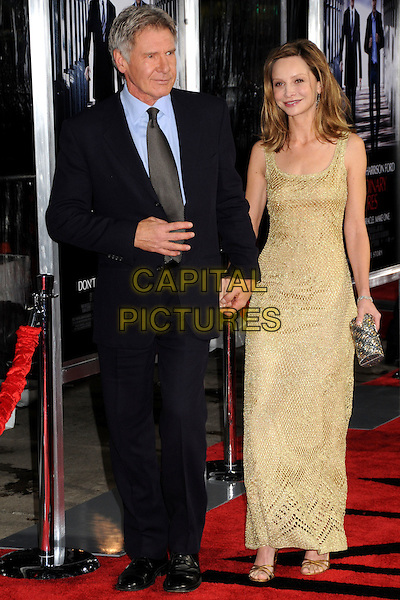 "HARRISON FORD & CALISTA FLOCKHART.""Extraordinary Measures"" Los Angeles Premiere held at Grauman's Chinese Theatre, Hollywood, California, USA..January 19th, 2010.full length couple black suit gold beige beads beaded dress chainmail maxi holding hands  clutch bag.CAP/ADM/BP.©Byron Purvis/AdMedia/Capital Pictures."