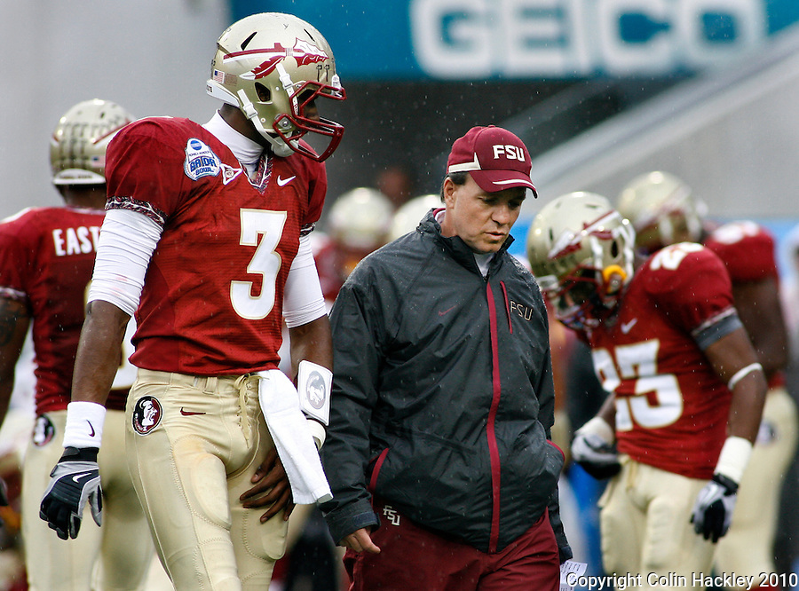 JACKSONVILLE, FL 1/1/10-FSU-WV FB CH13-Florida State Offensive Coordinator Jimbo Fisher talks with quarterback EJ Manuel prior to the Gator Bowl against West Virginia, Friday in Jacksonville, Fla. .COLIN HACKLEY PHOTO