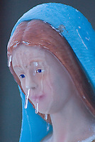 A statue of Mary in a manger scene wears a patina of ice and icicles hang from her face in Westerville, Ohio, Thursday, December 23, 2004.