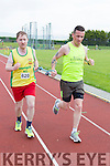 Ross Gallagher Gneeveguilla running the 5000m with the help of James Daly at the Kerry Senior Track and Field Championships in Castleisland on sunday