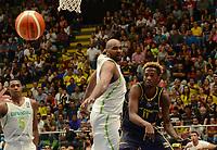 MEDELLÍN - COLOMBIA, 25-08-2017: Mariano LUCAS de Brasil disputa el balón con Braian ANGOLA de Colombia durante partido de la fase de grupos, grupo A, de la FIBA AmeriCup 2017 jugado en el coliseo Iván de Bedout de la ciudad de Medellín.  El AmeriCup 2017 se juega  entre el 25 de agosto y el 3 de septiembre de 2017 en Colombia, Argentina y Uruguay. / Mariano LUCAS of Brazil fights for the ball with Braian ANGOLA of Colombia during the match of the group stage Group A of the FIBA AmeriCup 2017 played at Ivan de Bedout  coliseum in Medellin. The AmeriCup 2017 is played between August 25 and September 3, 2017 in Colombia, Argentina and Uruguay. Photo: VizzorImage / León Monsalve / Cont