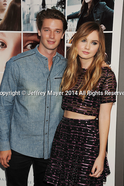 HOLLYWOOD, CA- AUGUST 20: Model Patrick Schwarzenegger (L) and actress Liana Liberato arrive at the Los Angeles premiere of 'If I Stay' at TCL Chinese Theatre on August 20, 2014 in Hollywood, California.