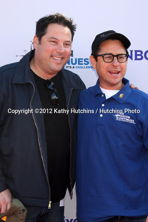 "LOS ANGELES - NOV 9:  Greg Grunberg, JJ Abrams at the Veterans Day Service Event to feed LA Children sponsored by ""The Mission Continues"" and ""Got Your 6"" organizations. at Globe Theater at Universal Studios on November 9, 2012 in Los Angeles, CA"