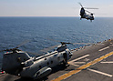 PACIFIC OCEAN (March 29, 2011) A CH-46E Sea Knight helicopter carrying humanitarian assistance supplies takes off from the forward-deployed amphibious assault ship USS Essex (LHD 2). Essex, with the embarked 31st Marine Expeditionary Unit (31st MEU), is operating off the coast of Kesennuma in northeastern Japan to support Operation Tomodachi. (Photo by U.S. Navy/AFLO) [0006]