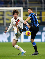 Calcio, Serie A: Inter Milano - AS Roma, Giuseppe Meazza stadium, December 6, 2019.<br /> Roma's Nicolò Zaniolo (l) in action with Inter's Stefan De Vrij (r) during the Italian Serie A football match between Inter and Roma at Giuseppe Meazza (San Siro) stadium, on December 6, 2019.<br /> UPDATE IMAGES PRESS/Isabella Bonotto