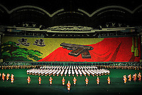 An image of Kim Il-Sung's pistol is diplayed as a mosaic made of 20,000 people holding colored cards during the Ariang Mass Gymnastic in Pyongyang, North Korea (DPRK) on 15 August 2007. 100,000 performers participate in the Mass gymnastics, the largest propaganda spectacle in the world